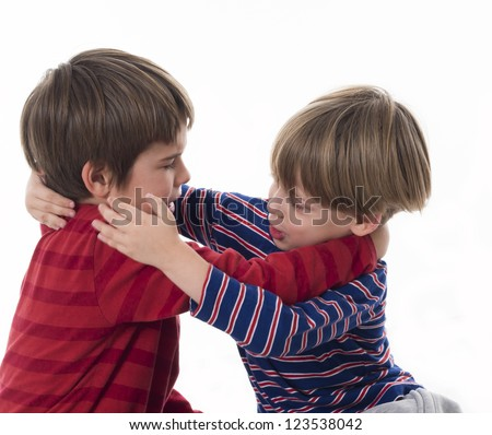 two brothers fighting - stock photo