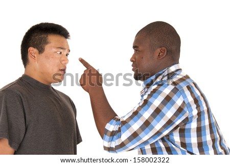 Two brothers in argument one pointing finger - stock photo