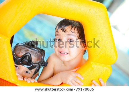 Two brothers in pool playing - stock photo