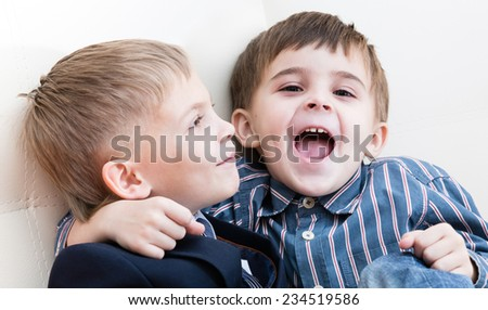 Two brothers play, one of them joyfully shouts