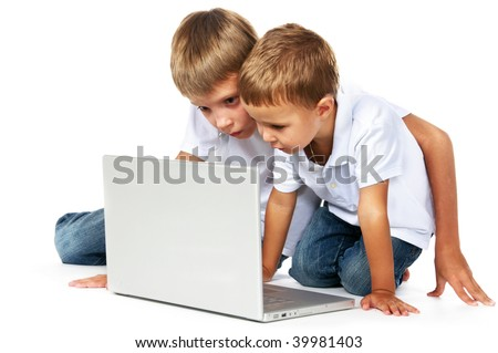 two brothers playing computer games - stock photo