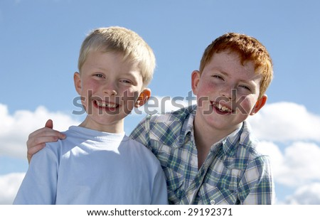 Two brothers playing in the park - stock photo