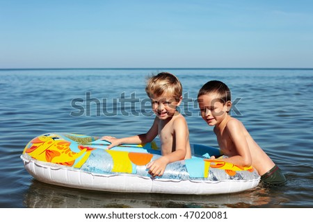 two brothers playing in the water - kids