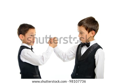 two brothers twins playing arm wrestling isolated on white background - stock photo