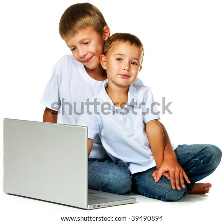 two brothers with laptop computer - stock photo
