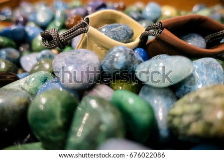 Two brown bags filled with colorful stones