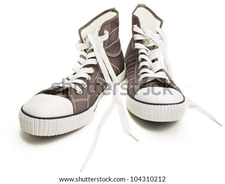 Two brown sneakers isolated on a white background. Closeup view. - stock photo