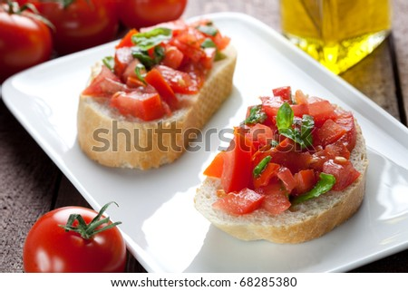 two bruschetta with tomato and basil - stock photo