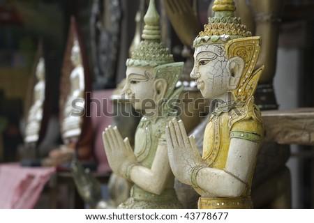 Two buddhist statues in Lamai (Koh Samui, Thailand) - stock photo