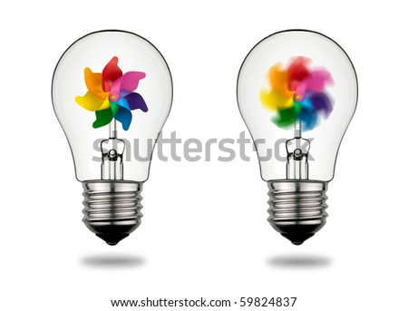 Two bulbs that symbolize the power of wind energy in electricity generation. Clipping path included. - stock photo
