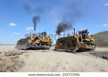 Two bulldozers. - stock photo