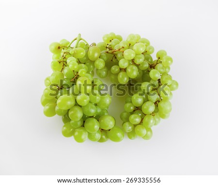 Two bunches of ripe tasty sweet green grapes. Top view. - stock photo