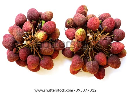 Two bunchs of fresh lychee on white background, seen from top. - stock photo
