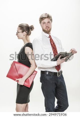 Two business colleagues, businessman standing with his female colleague smiling and looking to you, teamwork concept, isolated on white - stock photo