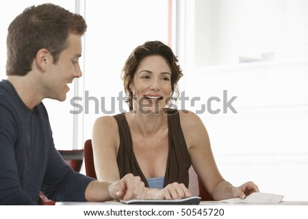 Two business colleagues in office meeting - stock photo