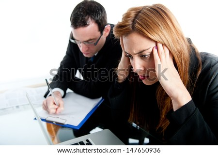 Two business colleagues looking very stressed in work - stock photo