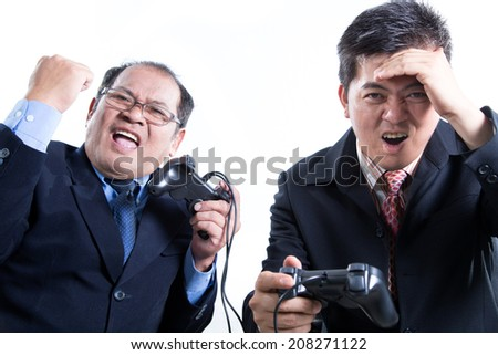 Two Business manager hold joystick for competition with white background  - stock photo