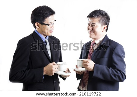 Two Business mans talking and drink the coffee Isolated on white background  - stock photo