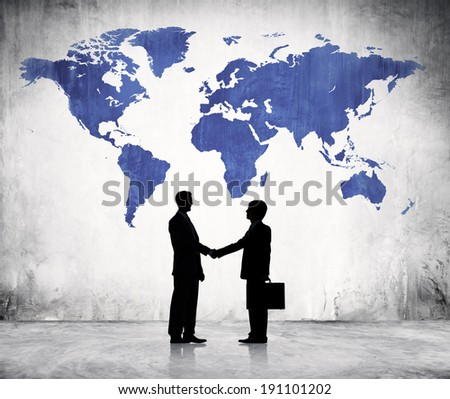Two Business Men Shaking Hands And A Blue Cartography Of The World Above. - stock photo