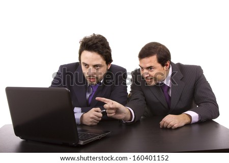 Two business men with laptop computer - stock photo