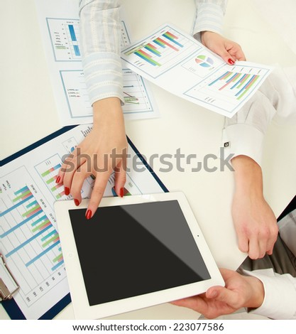 two business partners discussing documents lying. - stock photo