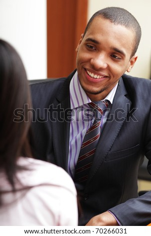 Two business partners having a conversation and laughing - stock photo