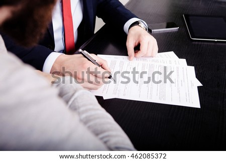 Two business partners signing a document. contract.