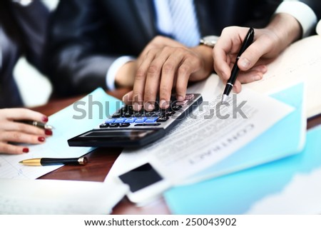 Two business partners signing contract - stock photo