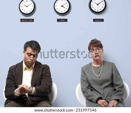 Two Business People Anxiously Waiting - stock photo