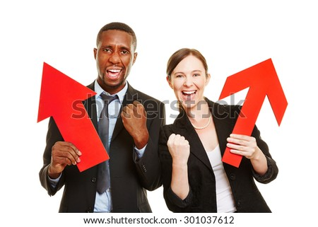 Two business people cheering with red arrows for motivation - stock photo