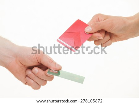 Two business people exchanging plastic cards, white background