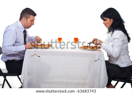 Two business people having lunch and eating pizza at table - stock photo