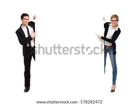 Two business people holding big banner. Full length studio shot isolated on white. - stock photo