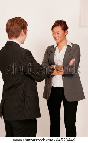 Two business people in conversation or small talk