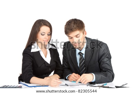 Two business people in elegant suits sitting at desk working in team together, discussing the problem, point finger, clipboard with papers, document, Isolated over white background