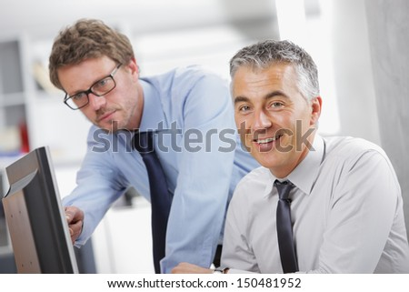 Two Business people in meeting in office - stock photo