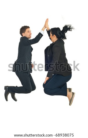 Two business people jumping and giving high five in the air isolated on white background - stock photo