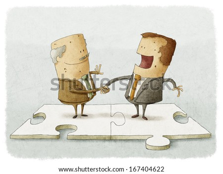 two business people on a puzzle make a handshake - stock photo