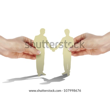Two business people shaking hands as partners - stock photo