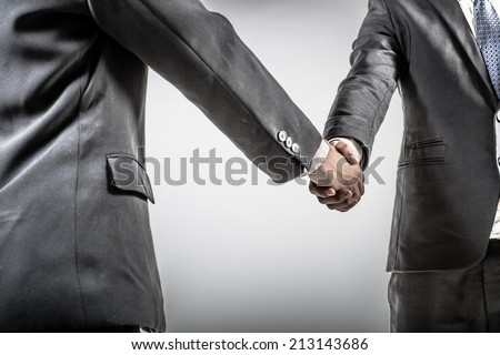 Two business people shaking hands. Isolated on white background. - stock photo