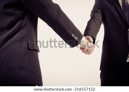 Two business people shaking hands. Isolated on white background.