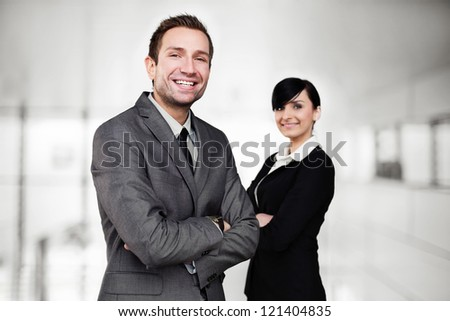 Two business people standing