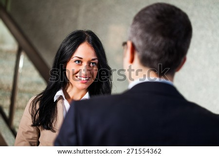 Two business people talking - stock photo