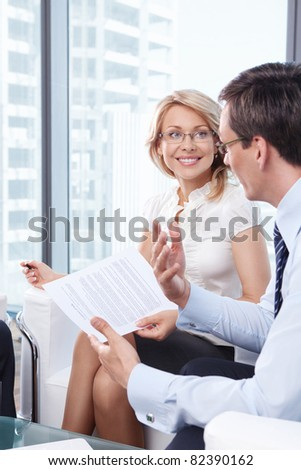 Two business people talking in the office - stock photo