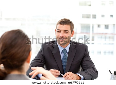 Two business people talking together during a meeting at the office