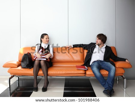 Two business people waiting for job interview - stock photo