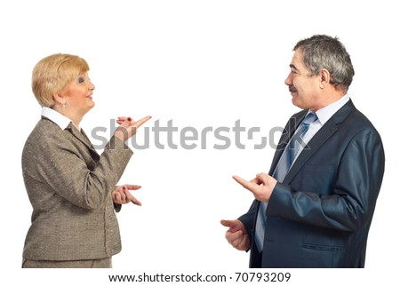 Two business people with conflicting opinions pointing to each other and discuss isolated on white background