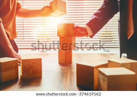 two business persons plan a project - stock photo