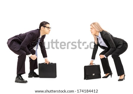 Two business rivals in sumo wrestling stance preparing for a fight isolated on white background - stock photo