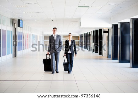 two business travellers walking in airport - stock photo